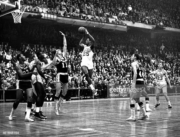 C Jones of the Boston Celtics looks to shoot as Frank Selvy of the Los Angeles Lakers goes for the block as Tom Snaders of the Celtics Elgin Baylor...