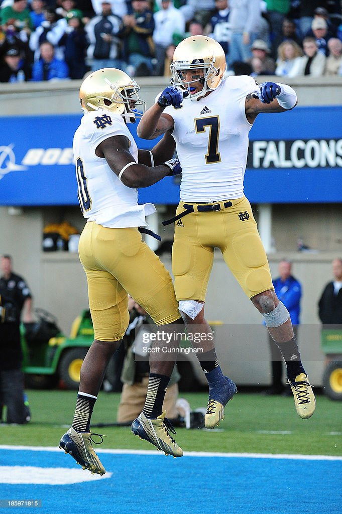 T. J. Jones #7 of the Notre Dame Fighting Irish celebrates with DaVaris Daniels #10 after making a catch for a touchdown against the Air Force Falcons at Falcon Stadium on October 26, 2013 in Colorado Springs, Colorado.