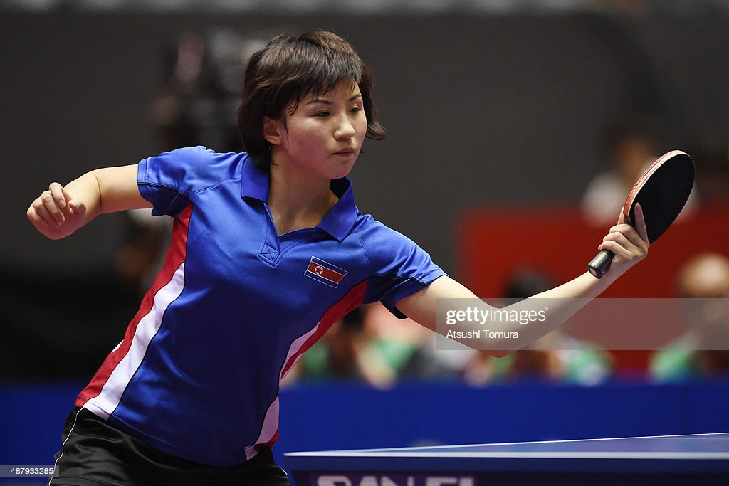 Jong Kim of North Korea plays a backhand against Yuling Zhu of China during day six of the 2014 World Team Table Tennis Championships at Yoyogi National Gymnasium on May 3, 2014 in Tokyo, Japan.