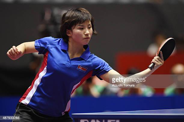 Jong Kim of North Korea plays a backhand against Yuling Zhu of China during day six of the 2014 World Team Table Tennis Championships at Yoyogi...