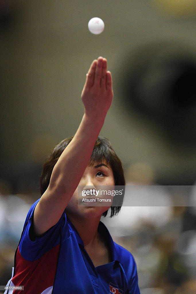 Jong Kim of North Korea serves against Ganna Gaponova of Ukraine during day five of the 2014 World Team Table Tennis Championships at Yoyogi National Gymnasium on May 2, 2014 in Tokyo, Japan.