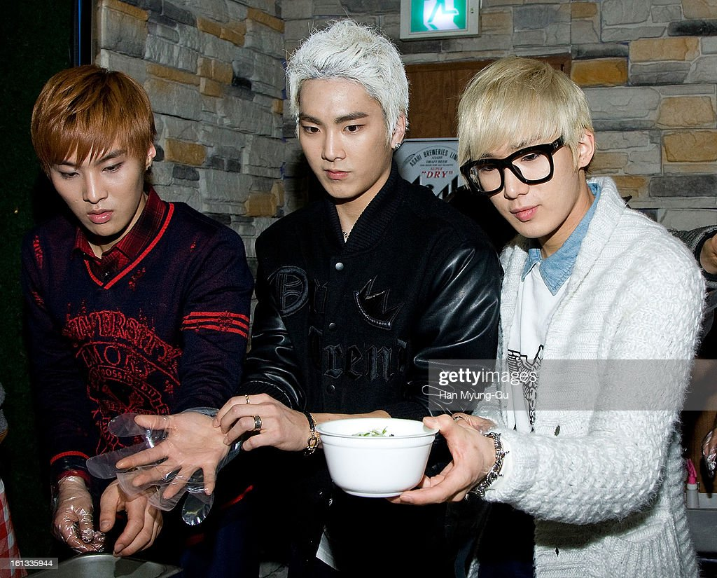 Jong Kook, Se Jun (C) and Tae Ha of South Korean boy band Speed pose for media during as hold tteokguk (rice-cake soup) at the Core Contents Media Artists New Year's Day Charity Event at Gibalhan Chicken Store on February 9, 2013 in Bucheon, South Korea.