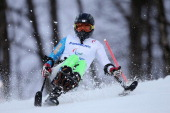 Jong Seork Park of South Korea competes in the Men's Slalom 1st Run Sitting during day six of Sochi 2014 Paralympic Winter Games at Rosa Khutor...