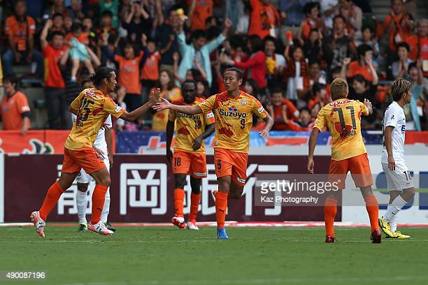 Jong Tae se of Shimizu SPulse scores his team's first goal with his team mates during the JLeague match between Shimizu SPulse and Sanfrecce...