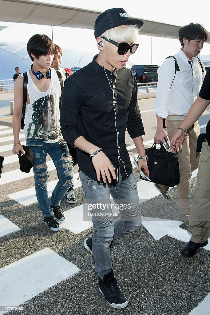 Jonghyun of South Korean boy band SHINee is seen on departure at the Incheon International Airport on August 26, 2013 in Incheon, South Korea.