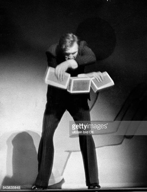 Jongleur Bela Krenn presenting his program in the Scala Theater Berlin Photographer Rene Fosshag Published by 'Die Dame' 24/1940Vintage property of...