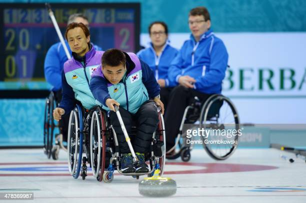 JongPan Kim of Korea competes in the Wheelchair Curling Round Robin Session 11 during day six of Sochi 2014 Winter Paralympic Games at Ice Cube...