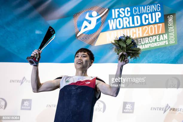 Jongwon Chon of Korea overall world cup winner celebrates on the podium with a trophy at the IFSC Climbing World Cup Munich on August 19 2017 in...