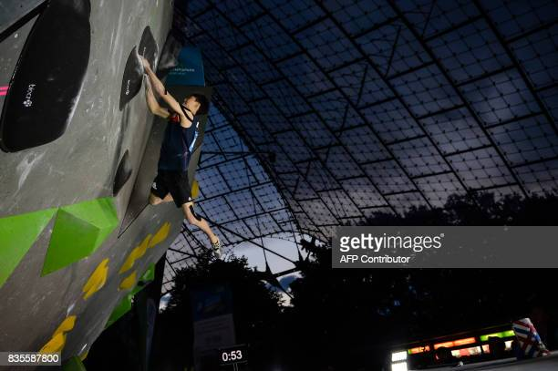 Jongwon Chon of South Korea competes during the men's event of the IFSC Bouldering Worldcup in the southern German city of Munich on August 19 2017 /...