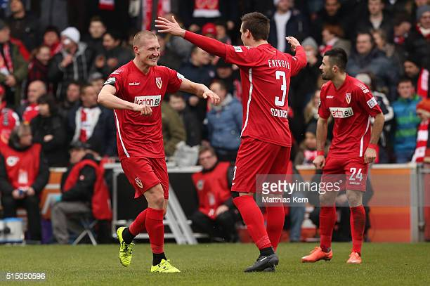 Joni Kauko of Cottbus jubilates with team mate Christopher Schorch after scoring the second goal during the third league match between FC Energie...