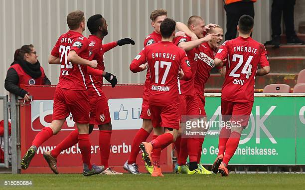 Joni Kauko of Cottbus jubilates with team mates after scoring the second goal during the third league match between FC Energie Cottbus and 1FC...