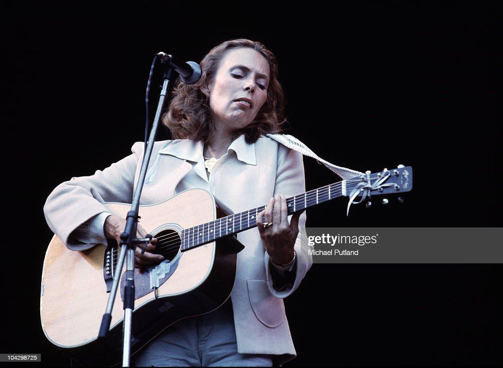 Joni Mitchell performs on stage, supporting Crosby, Stills, Nash and Young at Wembley Stadium, London, 14th September 1974.