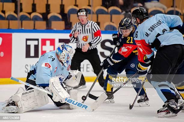 Joni Myllykoski Goaltender of Sonderjyske save from Mattias Tedenby of HV71during the Champions Hockey League group stage game between HV71 Jonkoping...