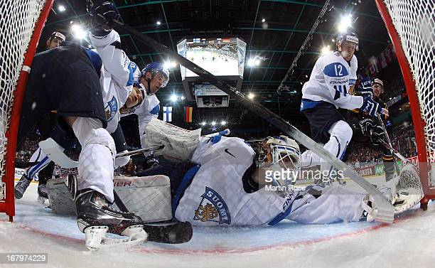 Joni Ortio goaltender of Finland makes a save during the IIHF World Championship group H match between Finland and Germany at Hartwall Areena on May...