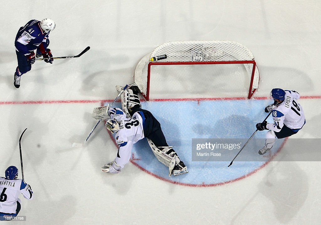 Joni Ortio (#31), goaltender of Finland makes a save on Pierre Bellemare (#41) of France during the IIHF World Championship group H match between Finland and France at Hartwall Areena on May 6, 2013 in Helsinki, Finland.