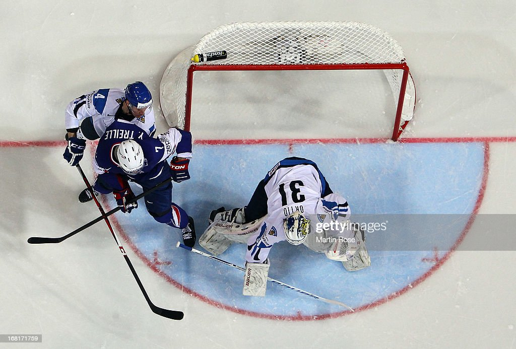 Joni Ortio (#31), goaltender of Finland makes a save on Yorick Treille (#7) of France during the IIHF World Championship group H match between Finland and France at Hartwall Areena on May 6, 2013 in Helsinki, Finland.