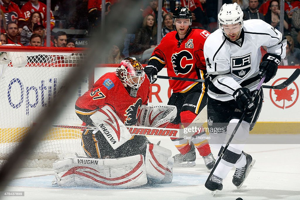 <a gi-track='captionPersonalityLinkClicked' href=/galleries/search?phrase=Joni+Ortio&family=editorial&specificpeople=4779725 ng-click='$event.stopPropagation()'>Joni Ortio</a> #37 of the Calgary Flames gets into position for a shot from Justin Williams #14 of the Los Angeles Kings at Scotiabank Saddledome on February 27, 2014 in Calgary, Alberta, Canada.