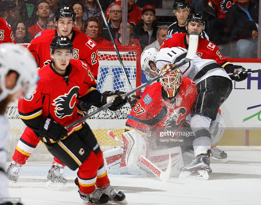 Joni Ortio #37 of the Calgary Flames makes a save through traffic against the Los Angeles King at Scotiabank Saddledome on April 5, 2016 in Calgary, Alberta, Canada.