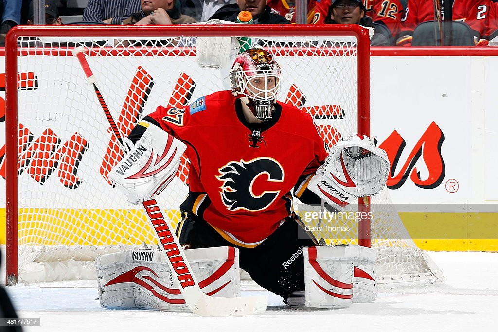 Joni Ortio #37 of the Calgary Flames skates against the Buffalo Sabres at Scotiabank Saddledome on March 18, 2014 in Calgary, Alberta, Canada. The Flames won 3-1.