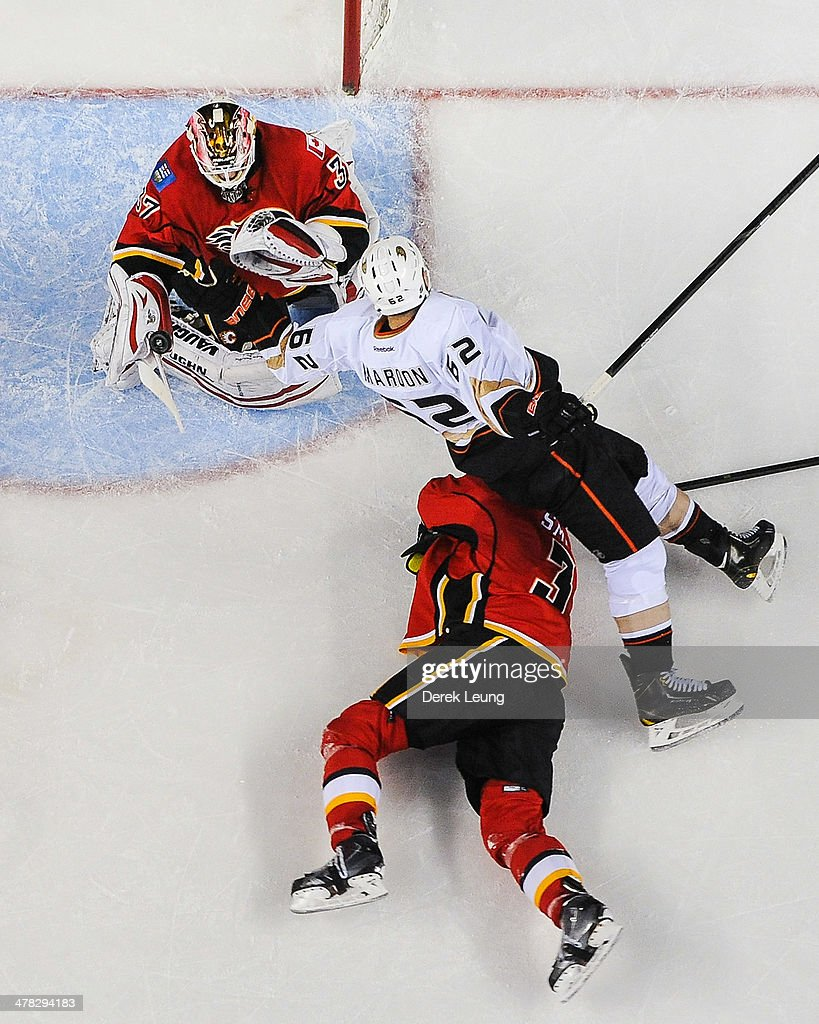 <a gi-track='captionPersonalityLinkClicked' href=/galleries/search?phrase=Joni+Ortio&family=editorial&specificpeople=4779725 ng-click='$event.stopPropagation()'>Joni Ortio</a> #37 of the Calgary Flames stops the shot of <a gi-track='captionPersonalityLinkClicked' href=/galleries/search?phrase=Patrick+Maroon&family=editorial&specificpeople=4589240 ng-click='$event.stopPropagation()'>Patrick Maroon</a> #62 of the Anaheim Ducks during an NHL game at Scotiabank Saddledome on March 12, 2014 in Calgary, Alberta, Canada. The Flames defeated the Ducks 7-2.