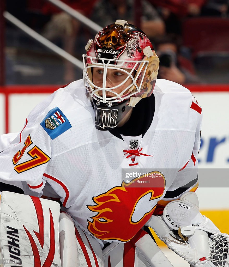 <a gi-track='captionPersonalityLinkClicked' href=/galleries/search?phrase=Joni+Ortio&family=editorial&specificpeople=4779725 ng-click='$event.stopPropagation()'>Joni Ortio</a> #37 of the Calgary Flames tends net against the Phoenix Coyotes at the Jobing.com Arena on March 15, 2014 in Glendale, Arizona. The Coyotes defeated the Flames 3-2.