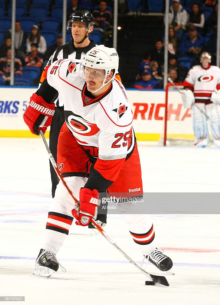 Joni Pitkanen #25 of the Carolina Hurricanes in action against the New York Islanders during their game at Nassau Veterans Memorial Coliseum on February 11, 2013 in Uniondale, New York.
