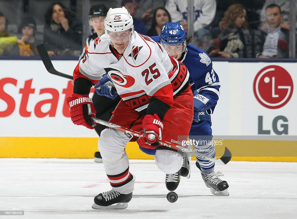 <a gi-track='captionPersonalityLinkClicked' href=/galleries/search?phrase=Joni+Pitkanen&family=editorial&specificpeople=204480 ng-click='$event.stopPropagation()'>Joni Pitkanen</a> #25 of the Carolina Hurricanes skates after aloose puck in a game against the Toronto Maple Leafs on February 4, 2013 at the Air Canada Centre in Toronto, Canada. The Hurricanes defeated the Leafs 4-1.