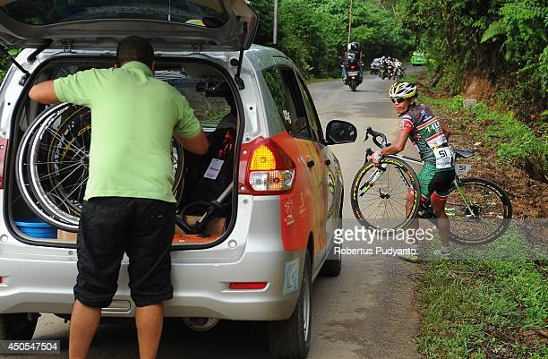 Jonipher Ravina's bike of Team 7 Eleven Roadbike Phillipine is damaged during stage 7 of the 2014 Tour de Singkarak from Silokek to Dharmasraya with...
