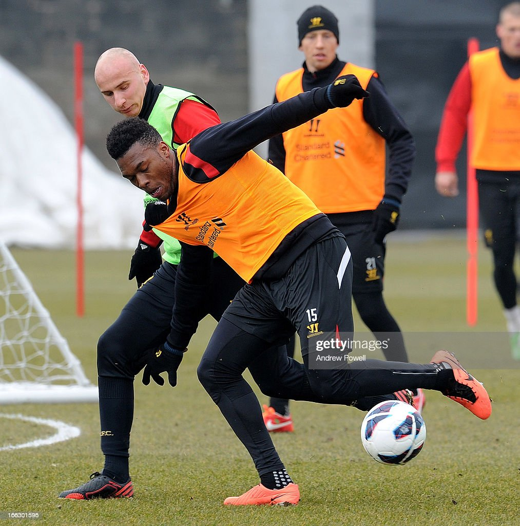Jonjo Shelvey and Daniel Sturridge of Liverpool in action during a training session at Melwood Training Ground on April 11, 2013 in Liverpool, England.