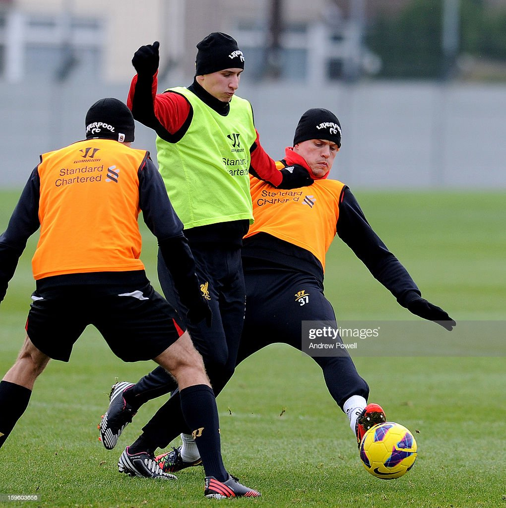 Jonjo Shelvey and Martin Skrtel of Liverpool in action during a training session at Melwood Training Ground on January 17, 2013 in Liverpool, England.