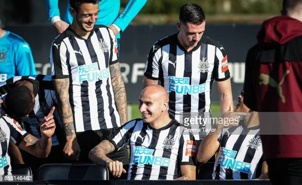 Jonjo Shelvey laughs as he sits in place during the Newcastle United Team photocall at the Newcastle United Training Centre on September 28 in...