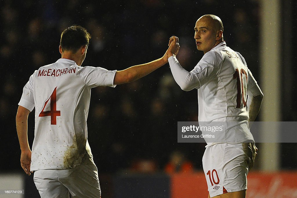 <a gi-track='captionPersonalityLinkClicked' href=/galleries/search?phrase=Jonjo+Shelvey&family=editorial&specificpeople=4940315 ng-click='$event.stopPropagation()'>Jonjo Shelvey</a> of England celebrates scoring the second goal with <a gi-track='captionPersonalityLinkClicked' href=/galleries/search?phrase=Josh+McEachran&family=editorial&specificpeople=6871629 ng-click='$event.stopPropagation()'>Josh McEachran</a> during the U-21 International match between England U-21 and Sweden U-21 at Banks' Stadium on February 5, 2013 in Walsall, England.
