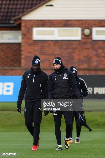 Jonjo Shelvey of Newcastle United and Mohamed Diame walk outside during the Newcastle United training session at the Newcastle United Training Centre...