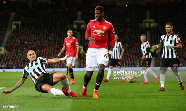 Jonjo Shelvey of Newcastle United and Paul Pogba of Manchester United in action during the Premier League match between Manchester United and...