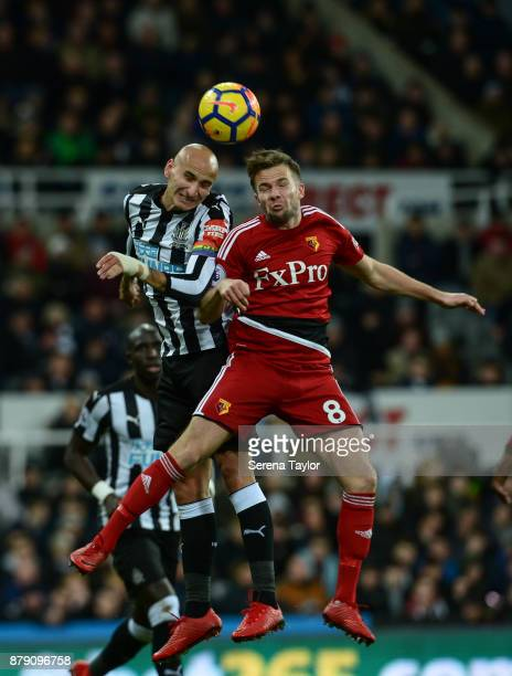 Jonjo Shelvey of Newcastle United and Tom Cleverley of Watford challenge to win a header during the Premier League match between Newcastle United and...