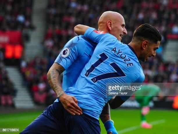 Jonjo Shelvey of Newcastle United celebrates with goalscorer Ayoze Perez during the Premier League match between Southampton and Newcastle United at...