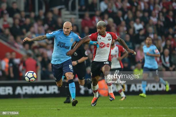 Jonjo Shelvey of Newcastle United controls the ball whilst being challenged by Mario Lemina of Southampton FC during the Premier League match between...
