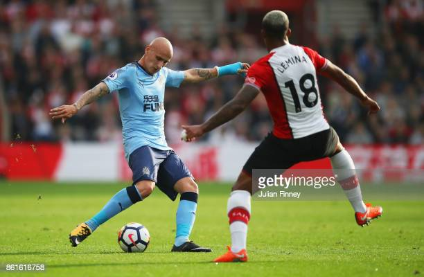 Jonjo Shelvey of Newcastle United is faced by Mario Lemina of Southampton during the Premier League match between Southampton and Newcastle United at...