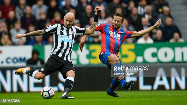 Jonjo Shelvey of Newcastle United passes the ball whilst Yohan Cabaye of Crystal Palace challenges him during the Premier League match between...
