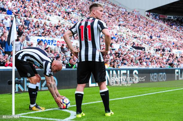 Jonjo Shelvey of Newcastle United places the ball in the corner whilst teammate Matt Ritchie looks out during the Premier League Match between...