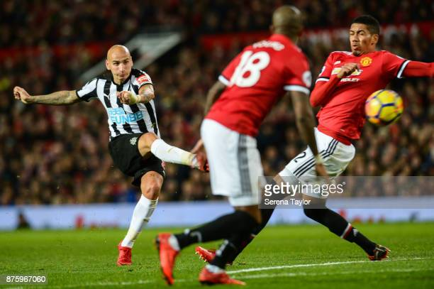 Jonjo Shelvey of Newcastle United strikes the ball during the Premier League match between Manchester United and Newcastle United at Old Trafford on...