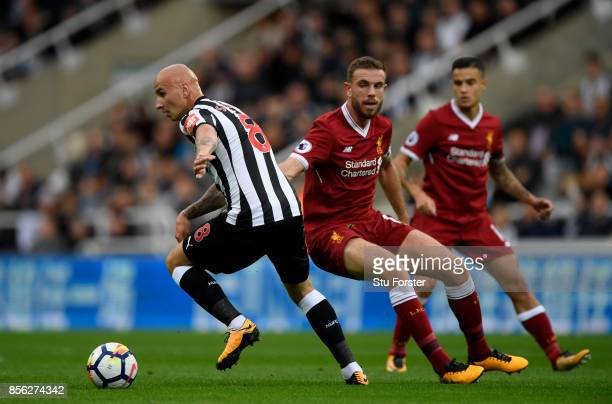 Jonjo Shelvey of Newcastle United takes the ball away from Jordan Henderson of Liverpool during the Premier League match between Newcastle United and...