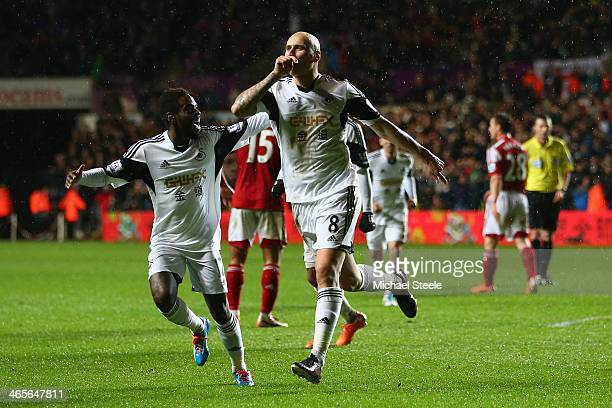 Jonjo Shelvey of Swansea City celebrates scoring the opening goal alongside Nathan Dyer during the Barclays Premier League match between Swansea City...