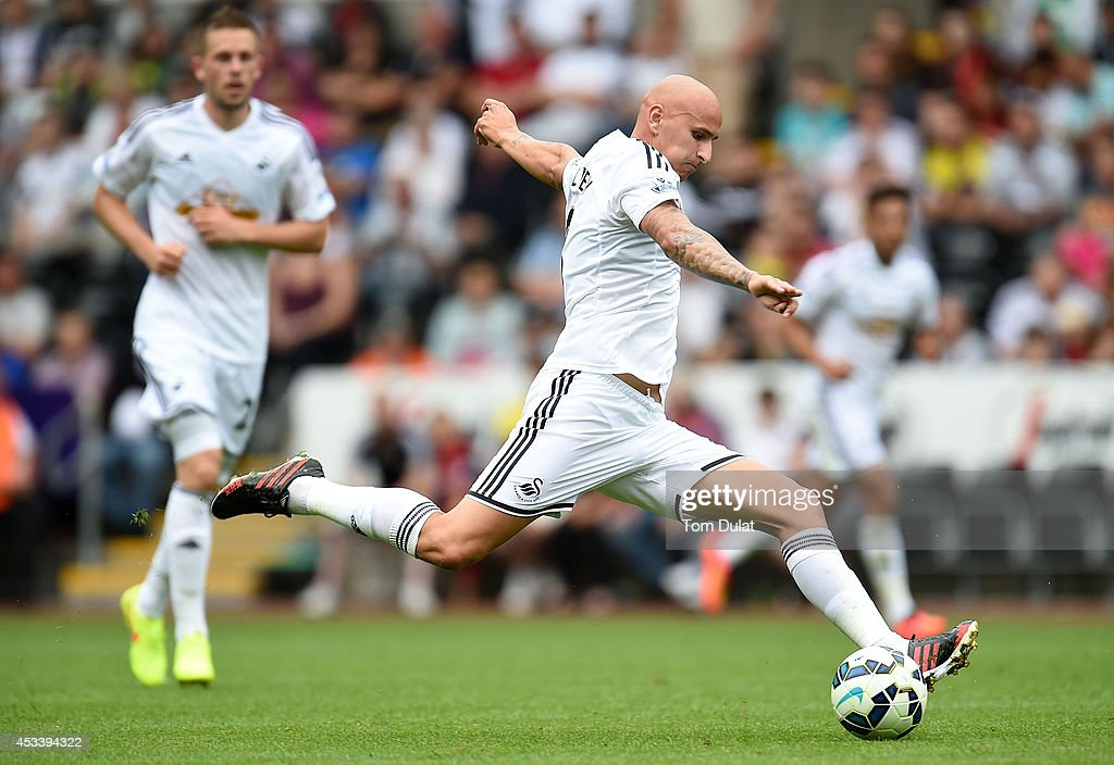 Jonjo Shelvey of Swansea City in action during a pre season friendly match between Swansea City and Villarreal at Liberty Stadium on August 09, 2014 in Swansea, Wales.