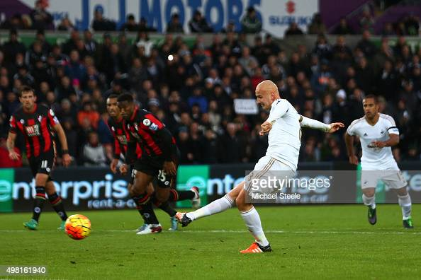 Jonjo Shelvey of Swansea City scores his team's second goal from the penalty spot during the Barclays Premier League match between Swansea City and...