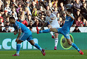 Jonjo Shelvey of Swansea crosses the ball over Patrick Van Aanholt and Jordi Gomez of Sunderland during the Premier League match between Swansea City...