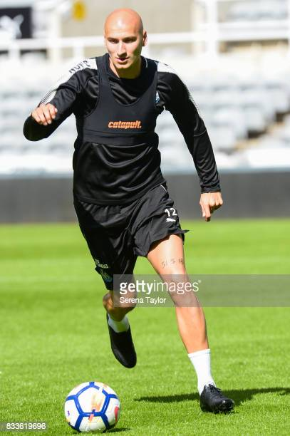 Jonjo Shelvey runs with the ball during a Newcastle United Open Training session at StJames' Park on August 17 in Newcastle upon Tyne England