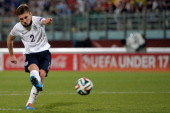 Jonjoe Kenny of England scores the final goal from a penalty during the UEFA Under17 European Championship 2014 final match between England and...