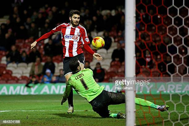 JonMiquel Toral of Brentford completes his hattrick by scoring his team's fourth goal past goalkeeper Joe Lewis of Blackpool during the Sky Bet...