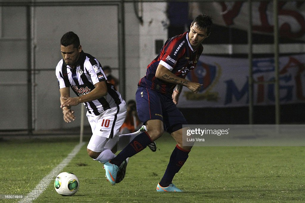 Jonnathan Fabbro (R ) of Cerro Porteño and Miguel Samudio (L) fight for the ball during the match between Libertad and Cerro Porteño for the Aperture APF, at Defensores del Chaco on March 03, 2013 in Asuncion, Paraguay.